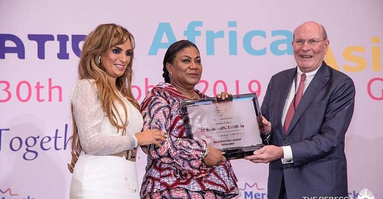 First Lady, Rebecca Akufo-Addo (middle) receiving an award from prof. Dr. Frank Stangenberg-Haverkamp, chairman of the Board of Trustees of Merck Foundation, with them is CEO Merck Foundation, Dr. Rasha Kelej.