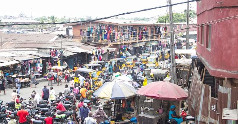 A tightly packed and busy urban slum in Ajegunle, Lagos, Nigeria. - Source: shutterstock