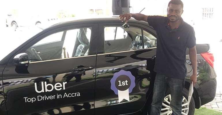 Joseph Mantey posing with his brand new Suzuki Dzire