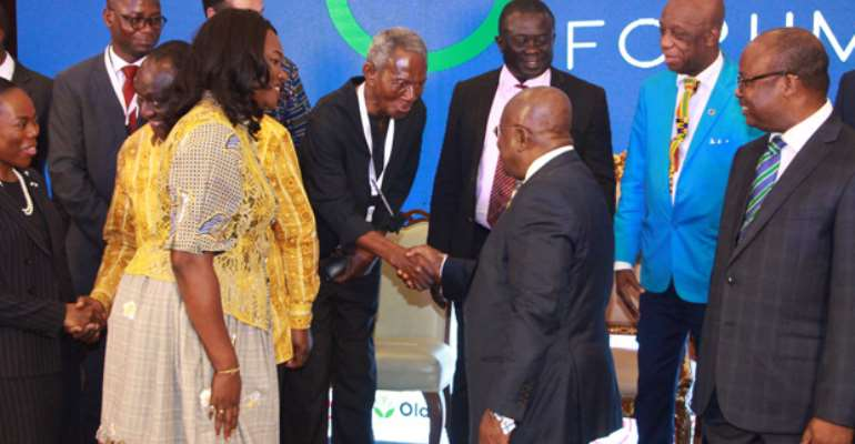 President Akufo-Addo in a handshake with Kwame Pianim. With him are Dr Edith Dankwa (left) and Dr Ernest Addison (right). Picture by Gifty Ama Lawson.