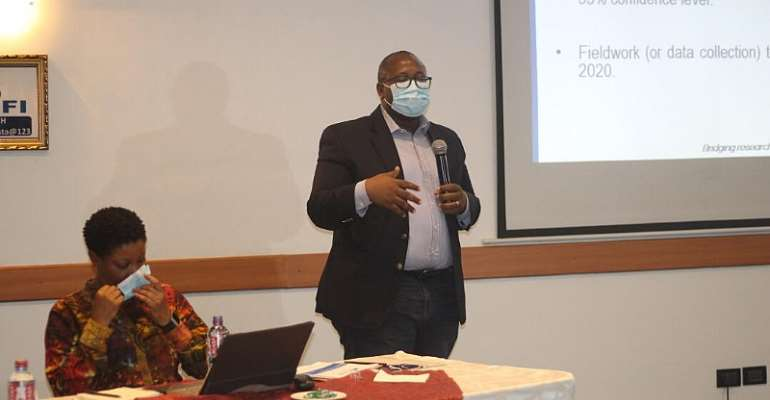 Officials of CDD-Ghana presenting the survey report