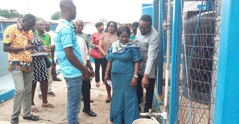 Minister for Sanitation and Water Resources, Hon. Cecilia Dapaah inspecting the sanitary conditions of a water station at Amasaman during the tour