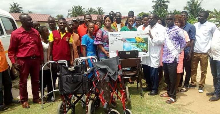 NPP Western Regional Treasurer donates wheelchairs, TV to Esiama Health Centre after defeat