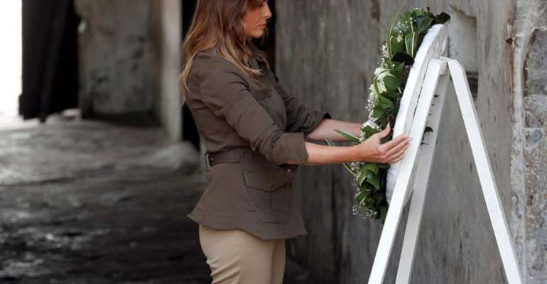 Mrs Melania Trump laying a wreath at the slave dungeon of the Cape Coast Castle