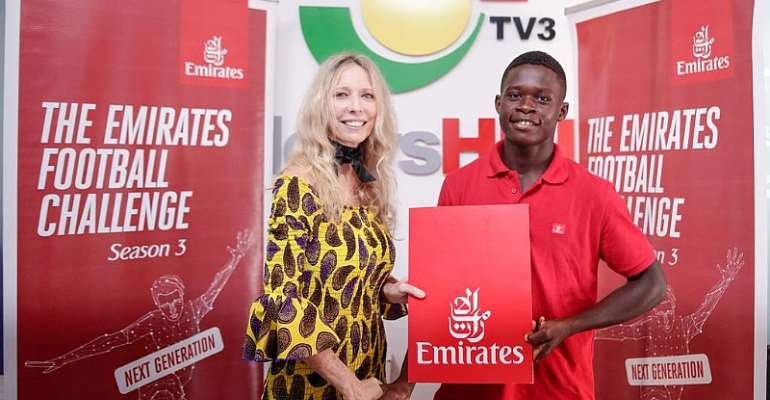 COUNTRY MANAGER OF EMIRATES, CATHRINE WESLEY PRESENTING THE TICKETS TO ABU SAMUEL