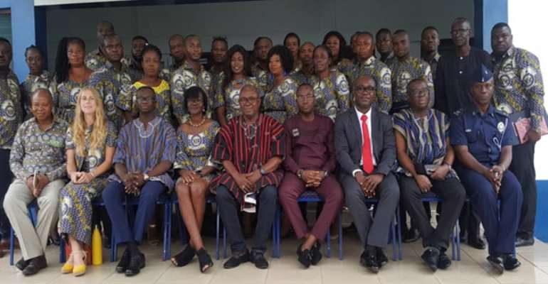 ACP George Tweneboah and other senior police officers in a group photograph with participants