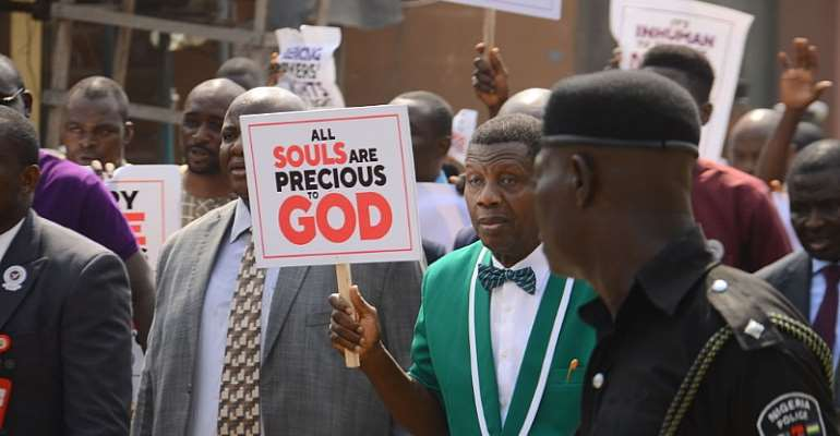The General Overseer of the Redeemed Christian Church of God, Enoch Adeboye, holding a placard, leading a protest in Lagos. - Source: Olukayode Jaiyeola/NurPhoto/Getty