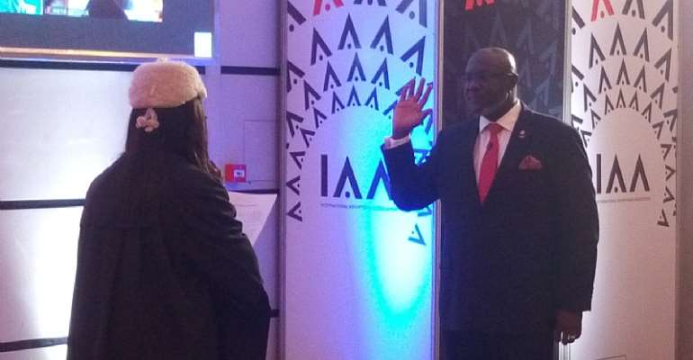 Mr. Joel Edmund Nettey being sworn in as President and Chairman of IAA by Her Ladyship Justice Olivia Obeng