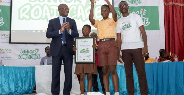 Mr. Ben Hassan Ouattara, Managing Director of Vivo Energy Ghana with winners of the road safety quiz competition, Mamprobi 1 Basic School