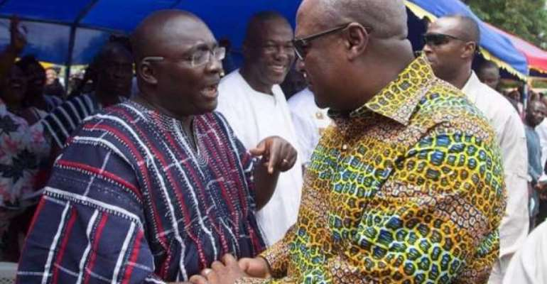 Dr Bawumia (left) exchanging pleasantries with President Mahama