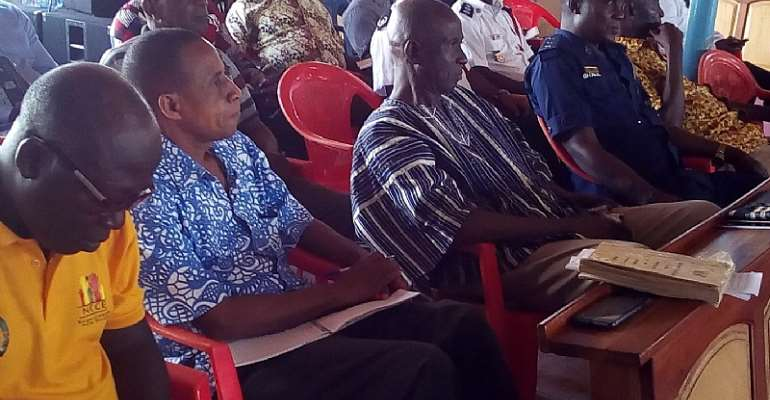 MCE for Berekum East, Mr. Kofi Adjei (in smock) with a cross-section of dignitaries at the Special Town Hall meeting