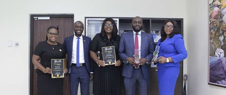 Matilda Asante-Asiedu (1st from right) and Olumide Olatunji (2nd from right) with some team members of the Bank