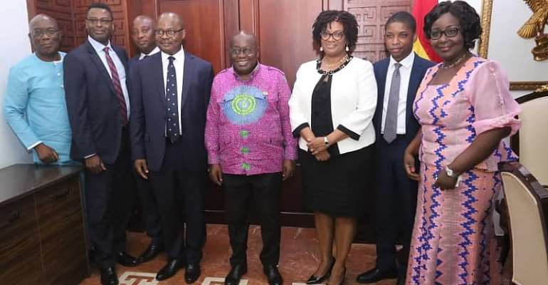 President Akufo-Addo in a group photograph with the Deposit Protection Scheme Board Members