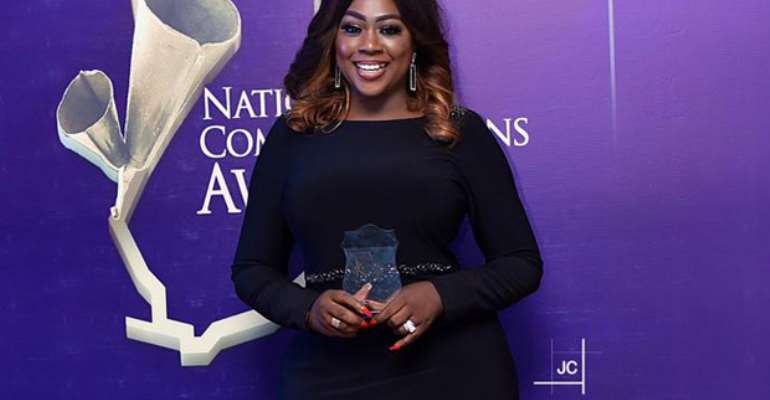 Roselyn Felli displaying one of the awards
