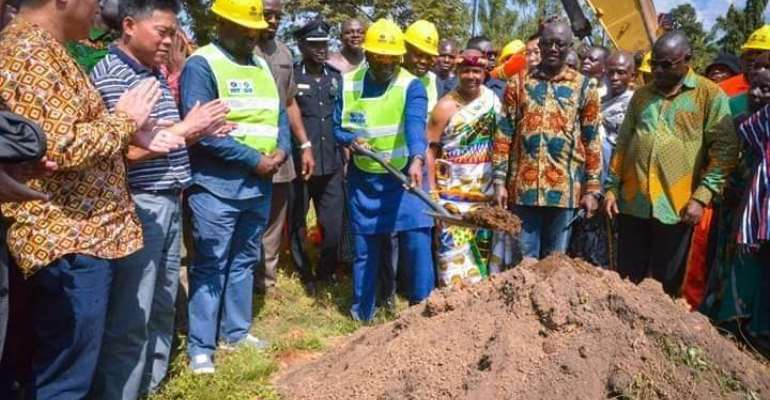 Vice President cutting sod for commencement of the project.