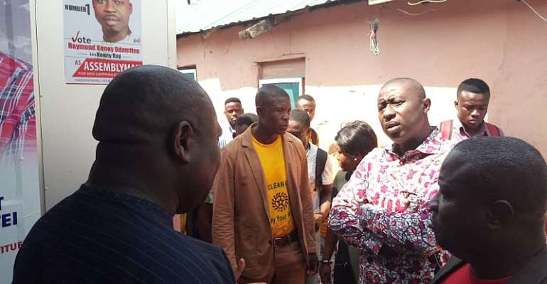 Deputy Sanitation Minister Hon. Patrick Buamah inspecting some toilet facilities provided by La Dade-Kotopon MCE and MP