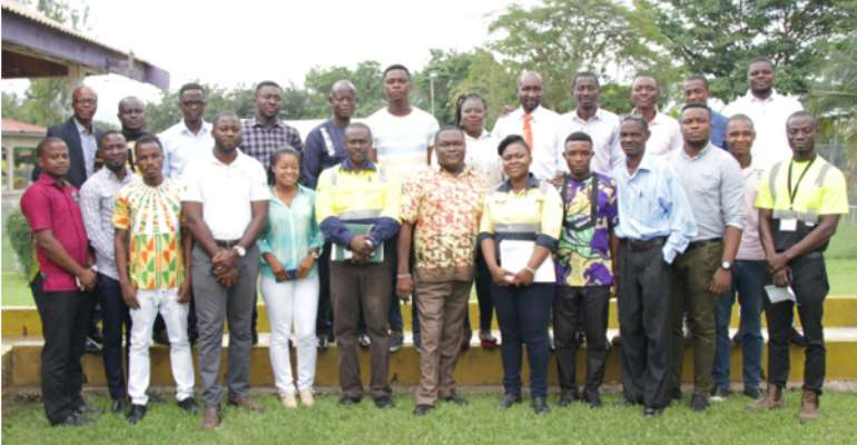 Nana Ampofo-Bekoe, Sustainability Manager (6th from right) in a group photograph with the facilitator and the journalists