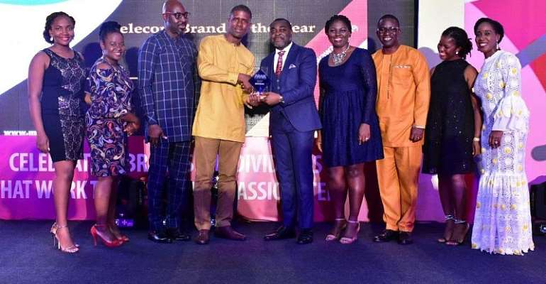 Germain Naatey, Media Planning Manager receiving Telecom Brand of the Year Award on behalf of MTN
