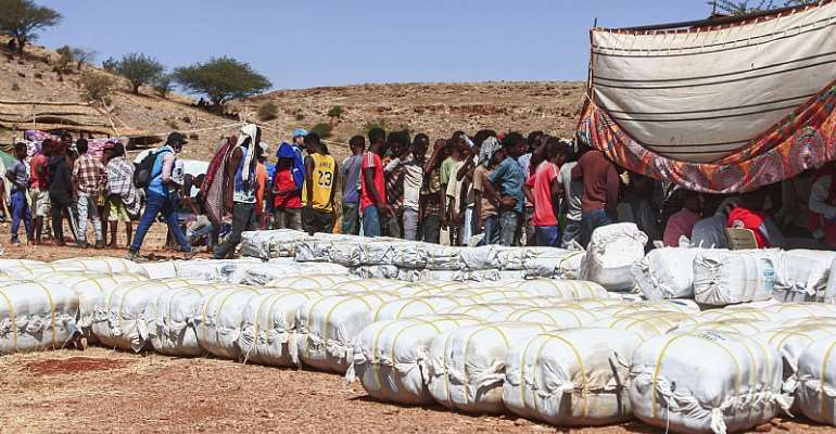 Ethiopian refugees fleeing fighting in Tigray province queue to receive supplies at the Um Rakuba camp in Sudan's eastern Gedaref province. - Source: Ebrahim Hamid/AFP via Getty Images