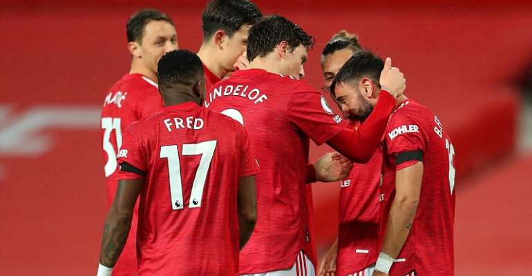 Bruno Fernandes of Manchester United celebrates with teammate Victor Lindelof after scoring his team's first goal during the Premier League match between Manchester United and West Bromwich Albion at Old Trafford  Image credit: Getty Images