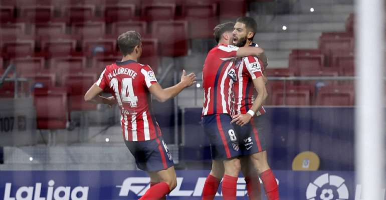 Yannick Carrasco of Atletico de Madrid celebrates with teammate Marcos Llorente and Saul Niguez after scoring his team's first goal during the La Liga Santander match between Atletico de Madrid and FC Barcelona at Estadio Wanda Metropolitano  Image credit: Getty Images