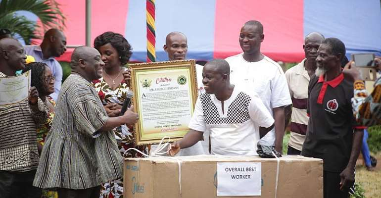 Mr. Kingsley Agyei Boahene (left) Presenting the citation to Mr. George Freeman