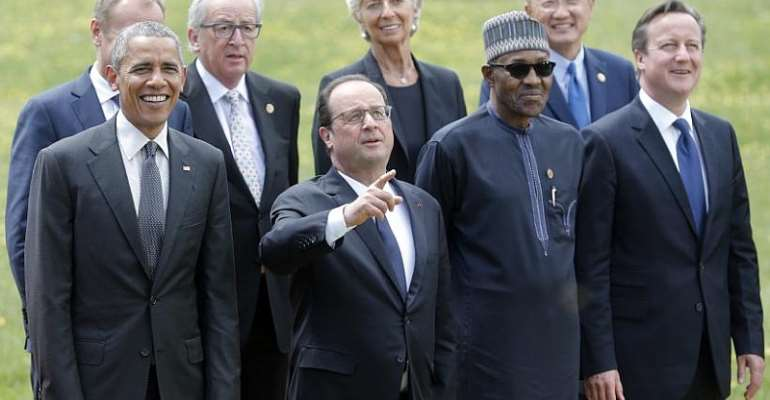 Former U.S. President Barack Obama (left) stands with Nigerian President Muhamamdu Buhari (second right), G7 summit participants and outreach delegates at a family picture event at the Elmau castle in Kruen, Germany, on 8 June 2015. Photo courtesy REUTERS/Christian Hartmann and right, Isioma Adeyemi as she celebrates her 'win'.