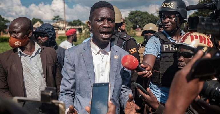 Ugandan musician-turned-politician Robert Kyagulanyi addresses the media after his car was shot at by police in eastern Uganda during his campaign. - Source: Photo by Sumy Sadurni/AFP via Getty Images