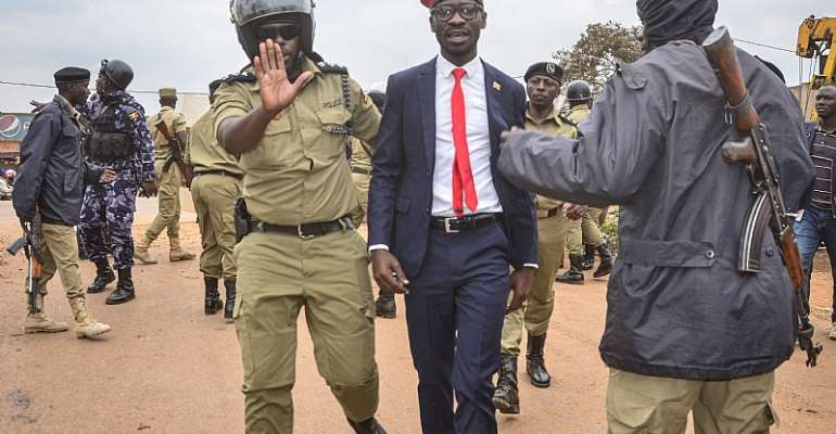 Ugandan singer-turned-politician Robert Kyagulanyi aka Bobi Wine being arrested on charges of unlawful assembly.  - Source: Stringer/AFP via Getty Images
