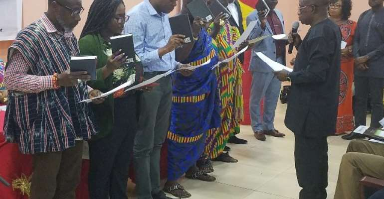 Ashanti Regional Minister, Simon Osei-Mensah (right) sworn in members of the committee