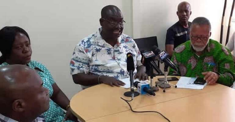 Isaac Bampoe Addo (M) addressed the press conference