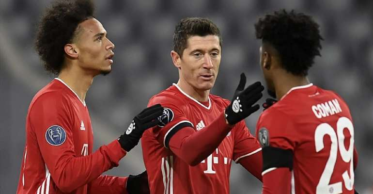 Bayern Munich's German midfielder Leroy Sane, Bayern Munich's Polish forward Robert Lewandowski and Bayern Munich's French forward Kingsley Coman