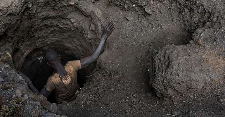 """A """"creuseur,"""" or digger, descends into a tunnel at the mine in Kawama, Democratic Republic of Congo. - Source: Michael Robinson Chavez/The Washington Post via Getty Images"""