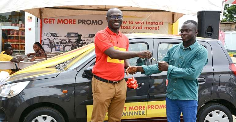 Mr.Jerry Boachie-Danquah (Left), Marketing Manager presenting the car key to the winner, Emmanuel Mais