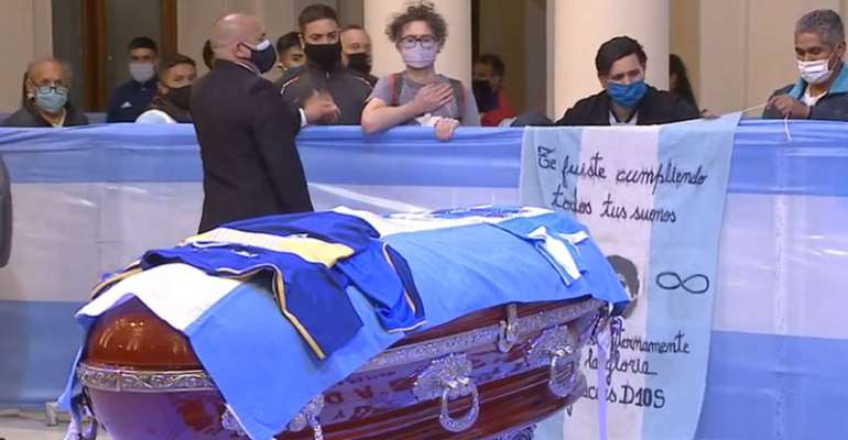 Some fans clapped, others wept, as they filed past Maradona's coffin