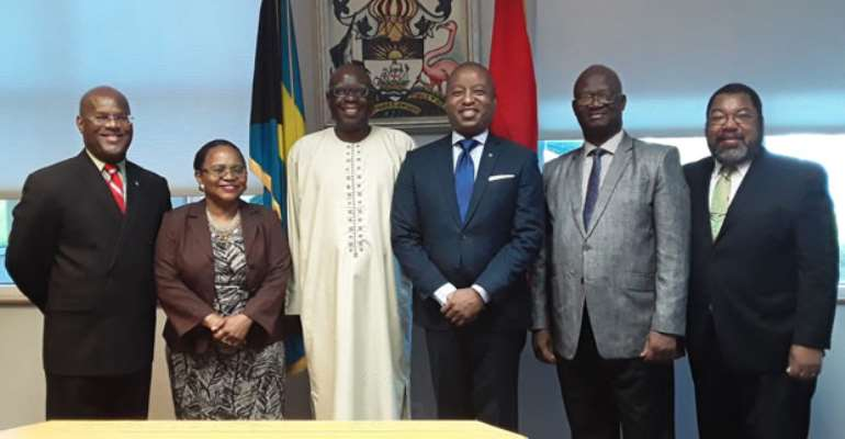 Napoleon Abdulai ( 3rd from left) and his host on his left in the midst of officials