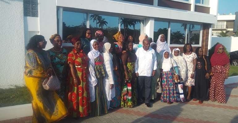 John Mahama in group photograph with members of the Federation of Muslim Women of Ghana, (FOMWAG)