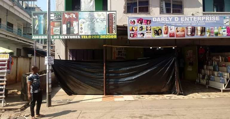 Front view of the store covered with a big size black polythene