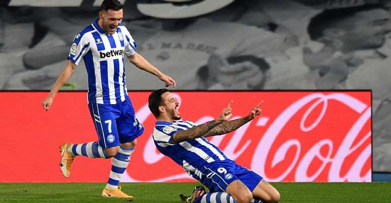 Alaves celebrate scoring against Real Madrid