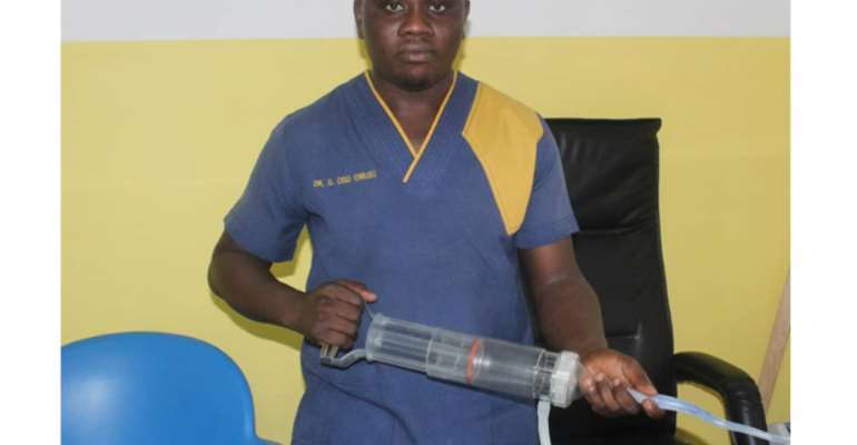 Dr Gerald Osei-Owusu with the hemafuse medical device