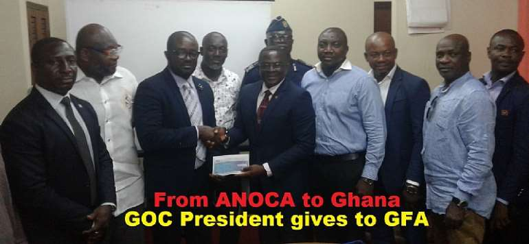 GOC President Hails GFA Boss Kurt Okraku As He Presents $8,000 To Olympic Football Team