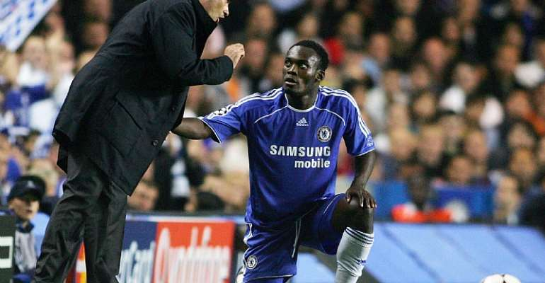 Michael Essien takes instructions from Jose Mourinho