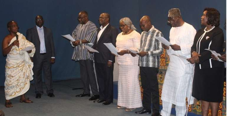 The board members taking their oath of office