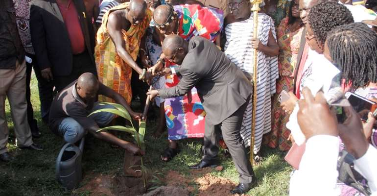Prof. Ebenezer Oduro Owusu (right) being assisted by Daasebre Prof. Emeritus Oti Boateng and other dignitaries in turning the sod for the project
