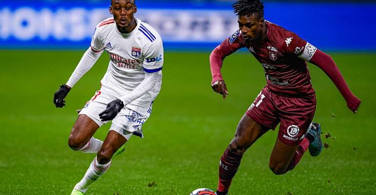 John Boye [Right] in action for FC Metz against Lyon on Sunday night. Photo Credit/FC Metz