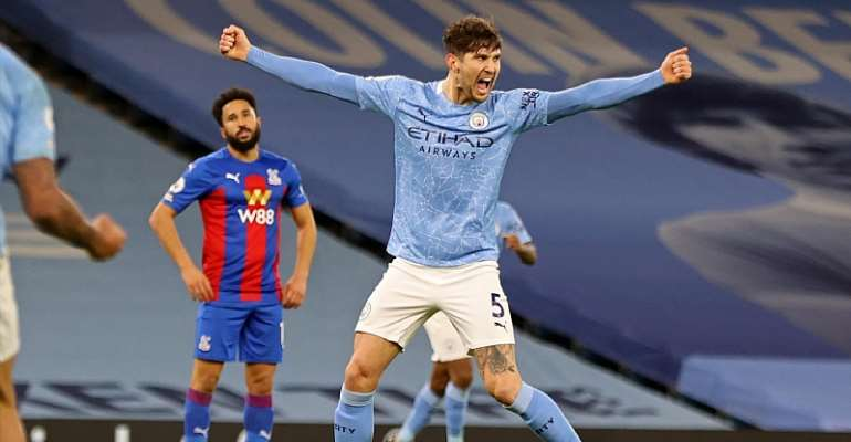 Manchester City's English defender John Stones celebrates after scoring their third goal during the English Premier League football match between Manchester City and Crystal Palace at the Etihad Stadium  Image credit: Getty Images