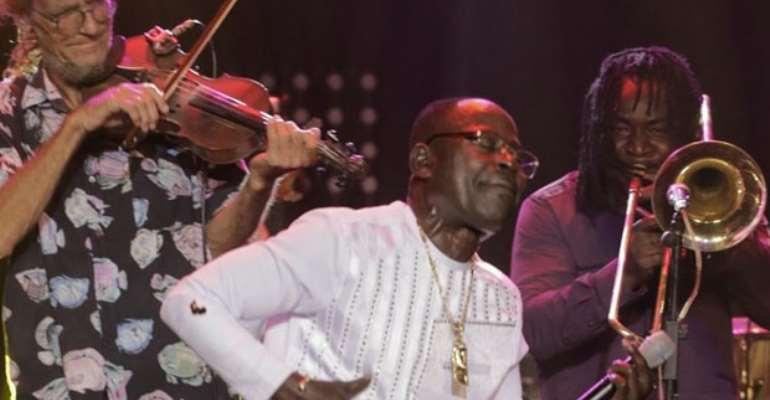 Amakye Dede performing on stage