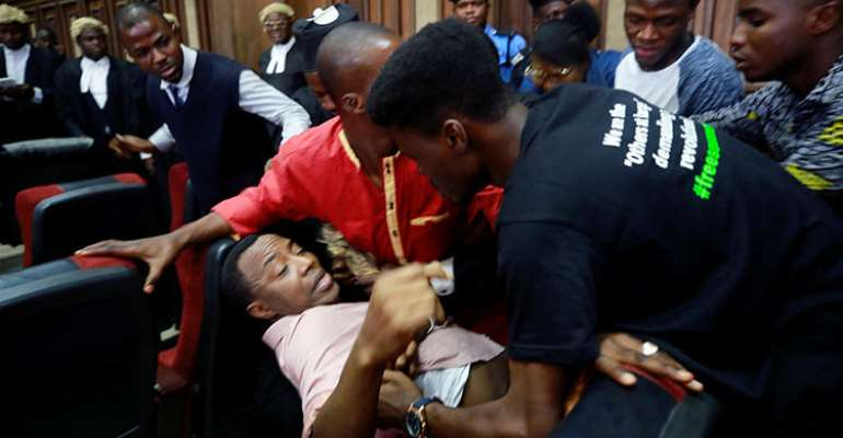 Fighting breaks out as security personnel attempt to re-arrest Nigerian activist and journalist Omoyele Sowore at the Federal High Court in Abuja, Nigeria, on December 6, 2019. Sowore and other activist-journalists have been jailed in Nigeria and Ethiopia amid a crackdown on free expression. (Reuters/Afolabi Sotunde)