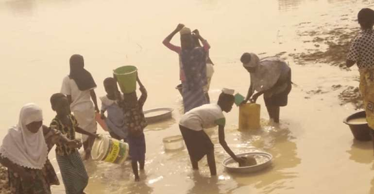 Some residents fetching polluted water from the dam