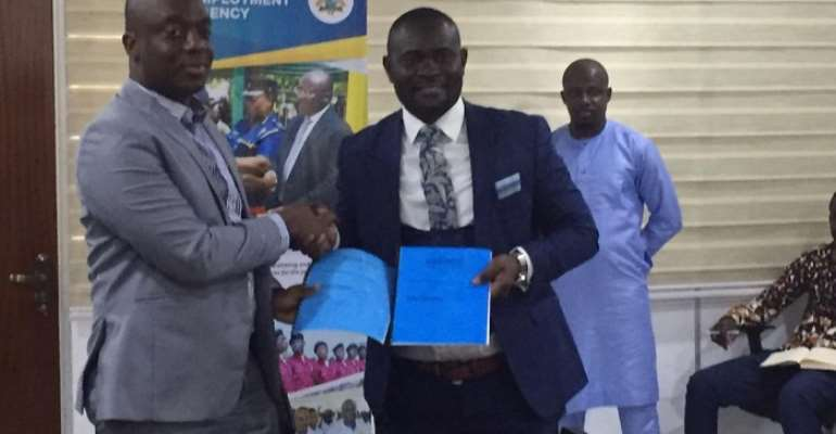 Mr. Frimpong (left) exchanging a copy of the MoU with Mr. Kumah